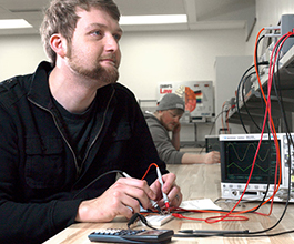 Student in electronics lab
